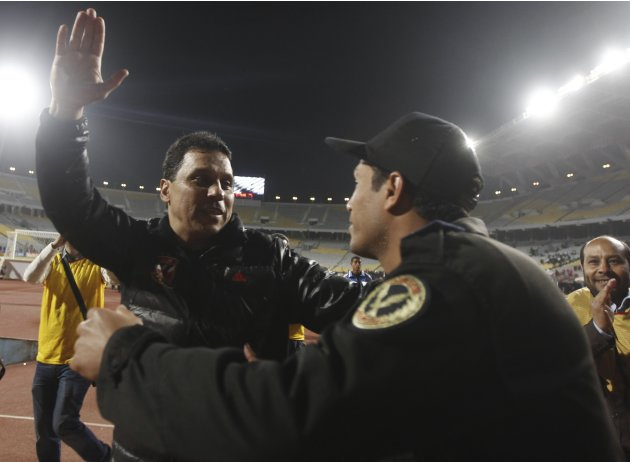 Al Badry, coach of Al Ahly, celebrates winning the CAF African Super Cup soccer match against AC Leopards in Alexandria