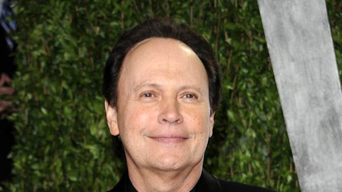 FILE - This Feb. 26, 2012 file photo shows Billy Crystal arriving at the Vanity Fair Oscar party in West Hollywood, Calif. Crystal has an agreement with Henry Holt and Company for a book that will be part memoir, part meditation _ with jokes _ about getting older. The book is currently untitled, and Crystal hopes to have it out when the big day arrives, March 14, 2013.  (AP Photo/Evan Agostini, file)