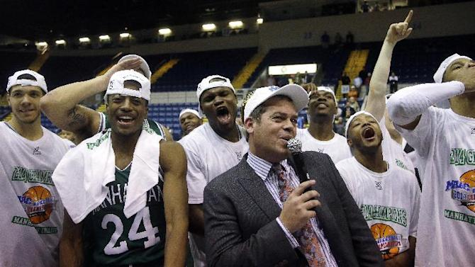Manhattan head coach Steve Masiello celebrates with his team as he addresses their fans after their NCAA men's MAAC conference championship tournament basketball finals game win over Iona in Springfield, Mass., Monday, March 10, 2014. Manhattan defeated Iona 71-68