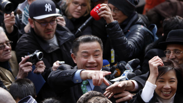 New York City Comptroller John Liu greets supporters after announcing the launch of his mayoral campaign on the steps of City Hall, Sunday, March 17, 2013 in New York.  Already the first person of Asian descent to be elected citywide in New York, Liu hopes to become the city's first Asian-American mayor. (AP Photo/Jason DeCrow)