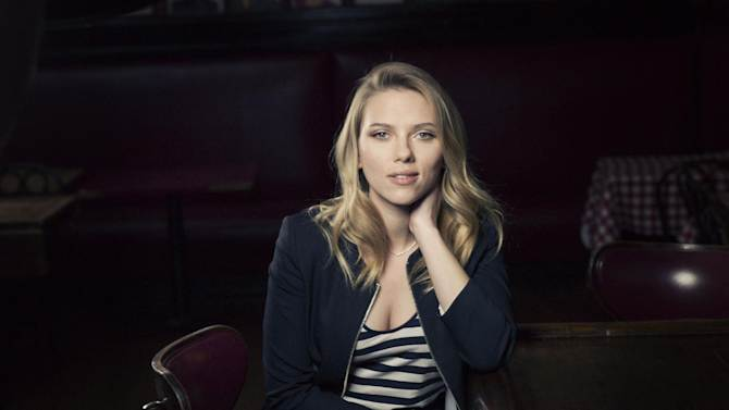 """In this Tuesday, Nov. 27, 2012 photo, American actress, model and singer, Scarlett Johansson, currently starring in """"Cat on a Hot Tin Roof"""" on Broadway, poses for a portrait, at Sardi's in New York. The actress with the pouty lips and gentle curves that GQ magazine once called """"Babe of the Year"""" is determined to be a more naturalistic Maggie the Cat in a revival of Tennessee Williams' """"Cat on a Hot Tin Roof"""" that opens Jan. 17, 2013. (Photo by Victoria Will/Invision/AP)"""