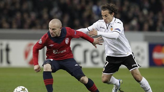 Lille's Florent Balmont challenges Valencia's Andres Guardado during their Champions League match at Lille Grand Stade in Villeneuve d'Ascq,