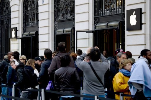 "Customers queue up to purchase Apple's new iPhone 5 in September. Apple sent out invitations for an event in exactly one week's time where the company is widely expected to unveil a new ""iPad Mini,"" a smaller version of its market-leading tablet computer"