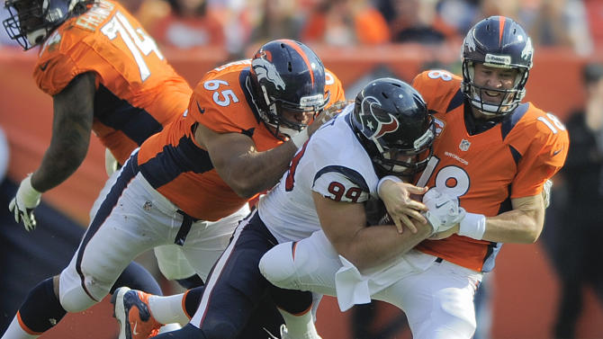 Denver Broncos quarterback Peyton Manning (18) is sacked by Houston Texans defensive end J.J. Watt (99) as guard Manny Ramirez (65) defends in the third quarter of an NFL football game Sunday, Sept. 23, 2012, in Denver. (AP Photo/Jack Dempsey)