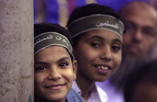 In this Wednesday, May 18, 2011 picture, two Egyptian boys wear headbands reading
