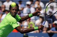 Gael Monfils, of France, returns a shot to Alejandro Gonzalez, of Colombia, during the second round of the 2014 U.S. Open tennis tournament, Friday, A...