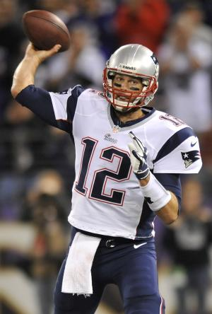 New England Patriots quarterback Tom Brady throws to a receiver in the first half of an NFL football game against the Baltimore Ravens in Baltimore, Sunday, Sept. 23, 2012. (AP Photo/Gail Burton)