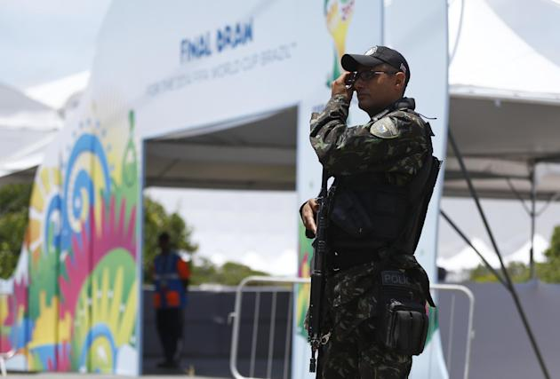 A soldier secures the entrance of the draw hall one day before the draw for the 2014 soccer World Cup in Costa do Sauipe near Salvador, Brazil, Thursday, Dec. 5, 2013