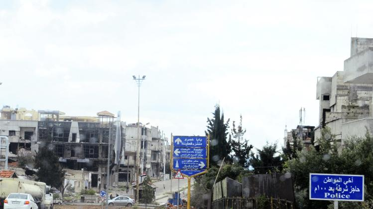 A police checkpoint sign is seen in the Baba Amr neighbourhood of Homs