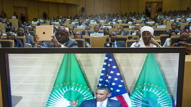 People look on as U.S. President Barack Obama delivers a speech to the African Union, Tuesday, July 28, 2015, in Addis Ababa, Ethiopia. On the final day of his African trip, Obama is focusing on economic opportunities and African security. (AP Photo/Evan Vucci)