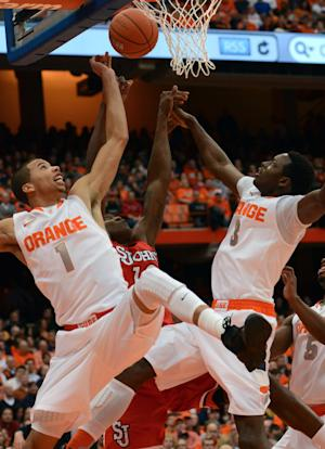 Syracuse's Michael Carter-Williams, left, and Jerami Grant team up to reject St. John's Chris Obekpa during the first half of an NCAA college basketball game in Syracuse, N.Y., Sunday, Feb. 10, 2013. (AP Photo/Kevin Rivoli)