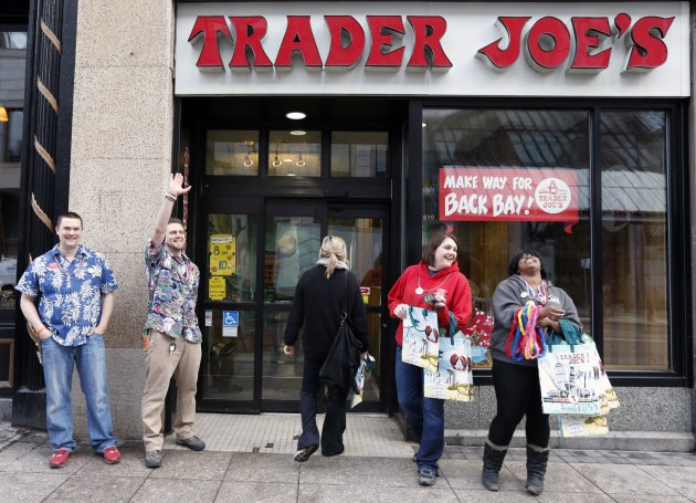 Employess greet people outside of Trader Joe's on Boylston Street in Boston, Wednesday, April 24, 2013. (AP Photo/Michael Dwyer)