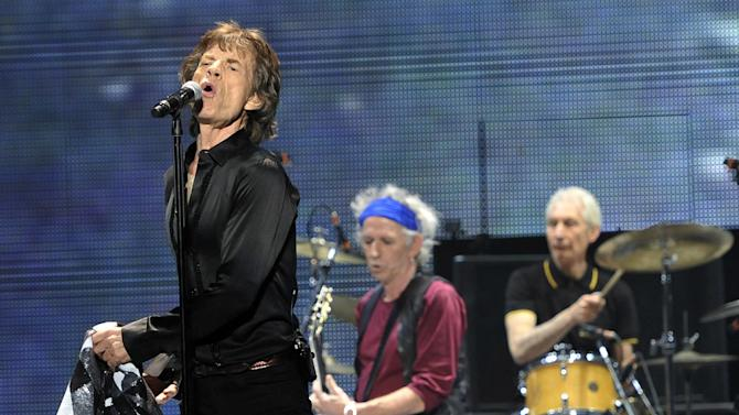 """Mick Jagger, left, Keith Richards, center, and Charlie Watts of the Rolling Stones perform on the kick-off of the band's """"50 and Counting"""" tour at the Staples Center on Friday, May 3, 2013 in Los Angeles. (Photo by Chris Pizzello/Invision/AP)"""
