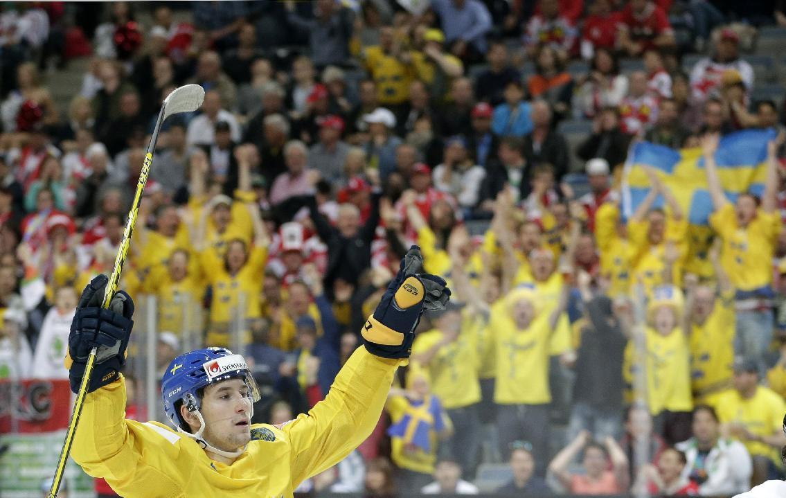 Defending champ Russia, Sweden record 2nd wins at worlds