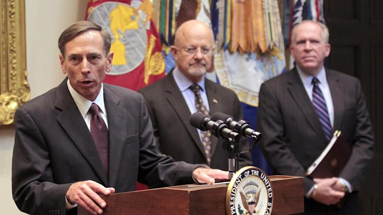 Dir. of the CIA David Petraeus, left, speaks following his swearing-in ceremony in the Roosevelt Room of the White House in Washington, Tuesday, Sept., 6, 2011. Also in the room looking on are James Clapper, center, Dir. of National Intelligence and John Brennan, far right, President Obama's chief counterterrorism adviser. (AP Photo/Pablo Martinez Monsivais)