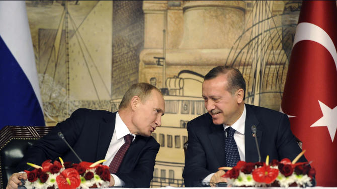 Russian President Vladimir Putin, left, and Turkey's Prime Minister Recep Tayyip Erdogan speak during a joint news conference after their talks, in Istanbul, Turkey, Monday, Dec. 3, 2012. The leaders of Russia and Turkey on Monday downplayed differences over how to end the Syrian civil war, saying they shared the common goal of trying to end the humanitarian crisis there. President Vladimir Putin of Russia, one of Syria's few remaining allies, said he understood Turkish concerns about its border security after Syrian shells hit Turkish territory in recent months. (AP Photo)
