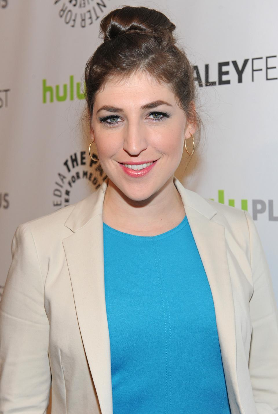 Mayim Bialik poses on arrival at the Paley Center for Media's PaleyFest, honoring The Big Bang Theory at the Saban Theatre, Wednesday March 13, 2013 in Los Angeles, California. (Photo by Kevin Parry/Invision/AP)