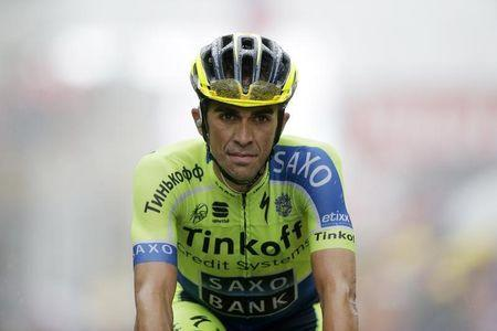 Tinkoff-Saxo team rider Alberto Contador of Spain crosses of the 161-km (100 miles) eighth stage of the Tour de France cycling race