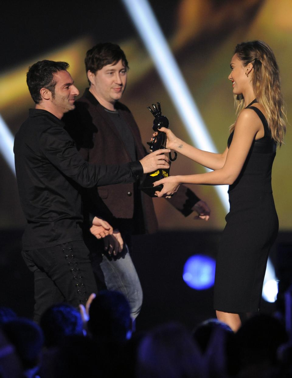 "From left, Jessica Alba presents the award for best action adventure to Raphael Colantonio and Harvey Smith for ""Dishonored"" at Spike's 10th Annual Video Game Awards at Sony Studios on Friday, Dec. 7, 2012, in Culver City, Calif. (Photo by Chris Pizzello/Invision/AP)"