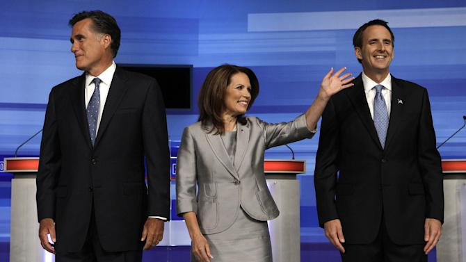 Republican presidential candidates former Massachusetts Gov. Mitt Romney, left, Rep. Michele Bachmann, R-Minn., center, former Minnesota Governor Tim Pawlenty pose for a photo before the start of the Iowa GOP/Fox News Debate at the CY Stephens Auditorium in Ames, Iowa, Thursday, Aug. 11, 2011. (AP Photo/Charlie Neibergall)