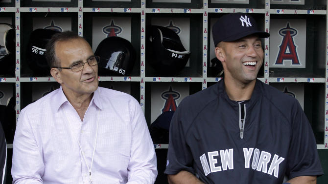Former New York Yankees manager Joe Torre, left, talks with Yankees' Derek Jeter in the dugout before a baseball game against the Los Angeles Angels in Anaheim, Calif., Friday, Sept. 9, 2011. (AP Photo/Jae C. Hong)