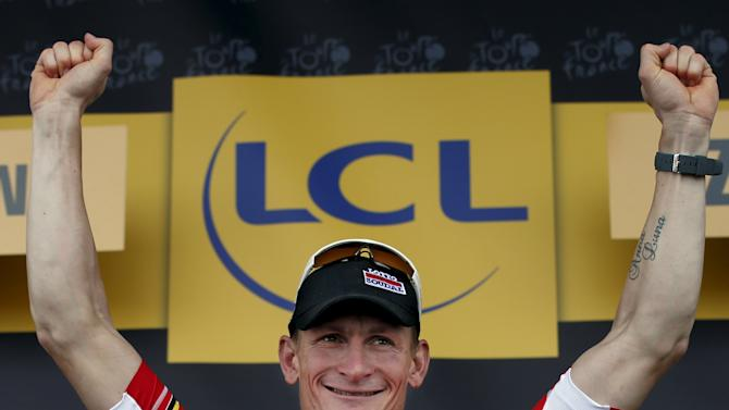 Lotto-Soudal rider Greipel of Germany celebrates on the podium after winning the second stage of the 102nd Tour de France cycling race from Utrecht to Zeeland