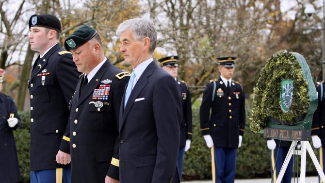 U.S. Army Second Lt. Christopher Kennedy McKelvy, left, great nephew of President John F. Kennedy, Brig. Gen. Edward M. Reeder, Jr., center, and Army Secretary John McHugh, right, pause after placing a wreath during a ceremony commemorating the 50th anniversary of President John F. Kennedy's designation of the name of the Special Forces Green Berets, Thursday, Nov. 17, 2011, at Arlington National Cemetery in Arlington, Va. (AP Photo/Ann Heisenfelt)