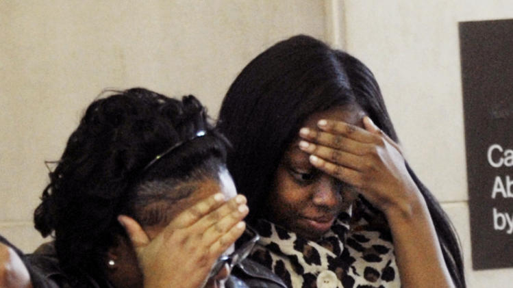 Family members of William Balfour leave the courthouse for lunch during the first day of his murder trial at the Cook County Criminal Court in Chicago, Monday, April 23, 2012. Balfour is charged in the 2008 murder of Oscar winning actress and singer Jennifer Hudson's mother, brother and nephew in Chicago. (AP Photo/Paul Beaty)