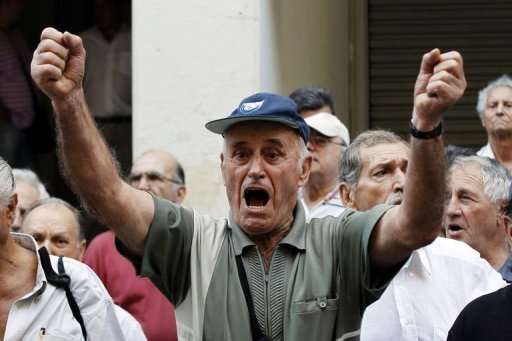 <p>A pensioner shouts slogans during a protest against health cuts in front of the Ministry of Health in Athens on Sepember 4. Greece's international creditors have been pressing the government to wrap up a new austerity plan to ensure the debt-crippled country stays afloat and in the eurozone.</p>