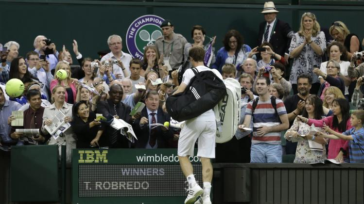 Andy Murray of Britain is solicited for autographs after defeating Tommy Robredo of Spain during their Men's singles match at the All England Lawn Tennis Championships in Wimbledon, London, Friday, June 28, 2013. (AP Photo/Anja Niedringhaus)