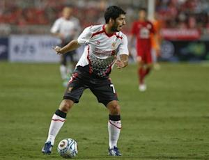Liverpool's Suarez controls the ball against Thailand's national soccer team during a friendly soccer match in Bangkok
