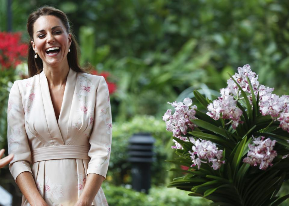 Kate, Duchess of Cambridge, smiles during a ceremony naming a hybrid orchid in their honor at the Orchid Garden within the Singapore Botanical Gardens in Singapore, Tuesday, Sept. 11, 2012. The Duke and Duchess of Cambridge are on an official three-day trip to Singapore. (AP Photo/Stephen Morrison, Pool)