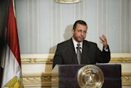 Egyptian Prime Minister Hisham Qandil gestures as he gives a press conference in Cairo