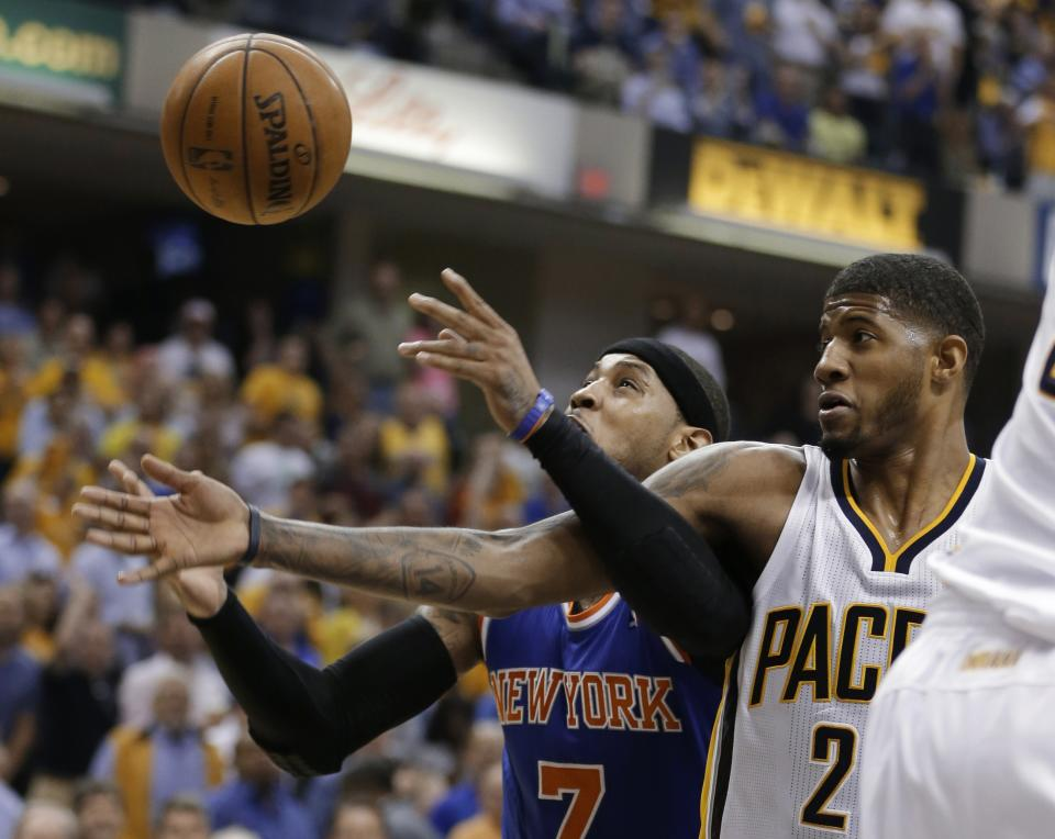 New York Knicks' Carmelo Anthony, left, and Indiana Pacers' Paul George compete for a rebound during the first half of Game 4 of an Eastern Conference semifinal NBA basketball playoff series, on Tuesday, May 14, 2013, in Indianapolis. (AP Photo/Darron Cummings)