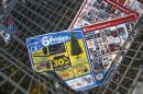 Black Friday advertisements are seen in the bottom of a shopping cart outside a shopping area in Westbury, New York