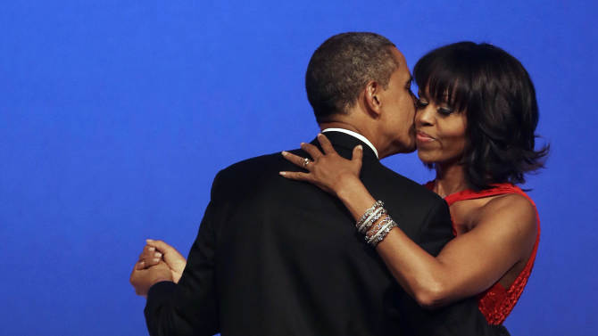 President Barack Obama kisses first lady Michelle Obama during their dance at the Commander-in-Chief Inaugural Ball at the Washington Convention Center during the 57th Presidential Inauguration on Monday, Jan. 21, 2013, in Washington. (AP Photo/Jacquelyn Martin)