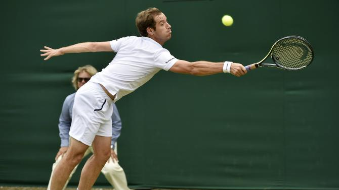 Richard Gasquet of France hits a shot during his match against Kenny De Schepper of France at the Wimbledon Tennis Championships in London