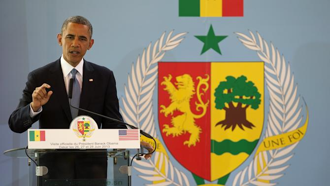 President Barack Obama gestures during a news conference with Senegalese President Macky Sall at the Presidential Palace in Dakar, Senegal, Thursday, June 27, 2013. Obama is visiting Senegal, South Africa, and Tanzania on a week long trip. (AP Photo/Evan Vucci)