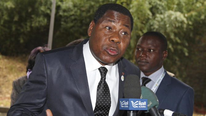 Benin President Thomas Yayi Boni addresses the media upon arrival for the Donor Conference for Development in Mali, in Brussels, Wednesday, May 15, 2013. Mali aims to raise 2 billion euros ($2.6 billion) at an international donor conference to fund its recovery after Islamist militants marched on Bamako this year, prompting a French military intervention. (AP Photo/Yves Logghe)