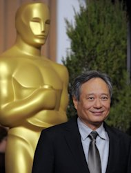 FILE - In this Monday, Feb. 4, 2013 file photo, Ang Lee, nominated for best picture and directing for &quot;Life of Pi,&quot; arrives at the 85th Academy Awards Nominees Luncheon at the Beverly Hilton Hotel, in Beverly Hills, Calif. With 11 Academy Awards nominations, second only to Lincoln with 12, and the sort of global box-office receipts normally reserved for superheroes, Life of Pi is one of the most unusual megahits ever to hit the big-screen. (Photo by Chris Pizzello/Invision/AP, File)
