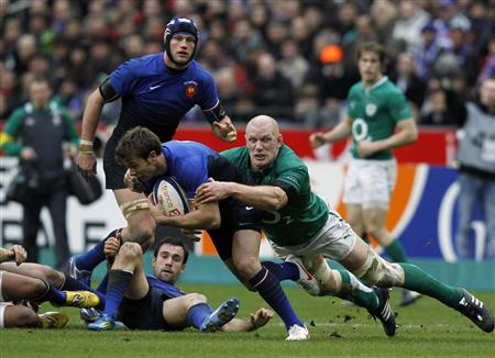 France's Vincent Clerc is tackled by Ireland's Paul O'Connell during their Six Nations rugby union match at the Stade de France in Saint-Denis