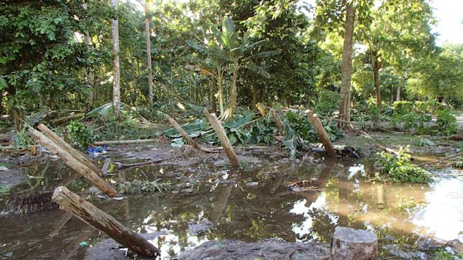 In a photo provided by Work Vision, a village is destroyed in the area of Lata, Temotu province, Solomon Islands after a powerful earthquake off the Solomon Islands on Wednesday, Feb. 6, 2013 generated a tsunami of up to 1.5 meters (about 5 feet) that damaged dozens of homes and left at least four people missing and presumed dead in the South Pacific island chain. (AP Photo/World Vision)