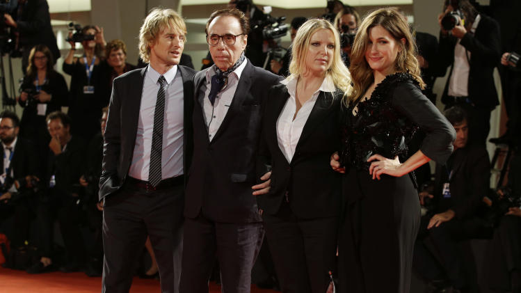 From left, actor Owen Wilson, director Peter Bogdanovich, Louise Stratten, and actress Kathryn Hahn arrive for the premiere of the movie She's Funny That Way at the 71st edition of the Venice Film Festival in Venice, Italy, Friday, Aug. 29, 2014. (AP Photo/Andrew Medichini)