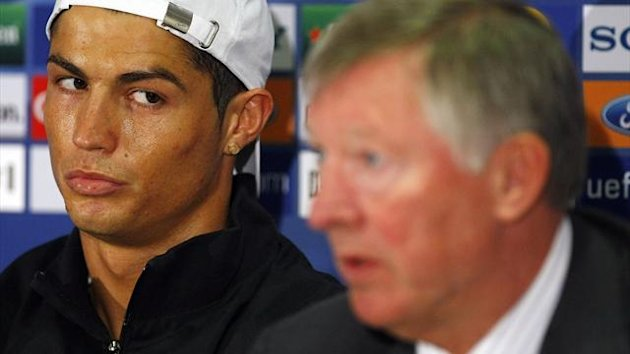 Cristiano Ronaldo (L) is seen looking towards manager Alex Ferguson