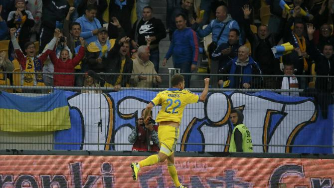 Ukraine's Kravets celebrates his goal against Belarus during their Euro 2016 group C qualification match at Arena Lviv stadium in Lviv