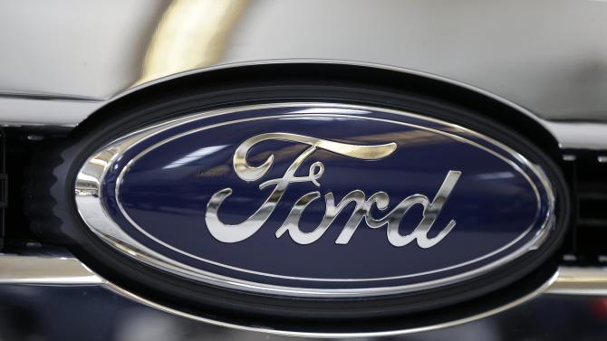 FILE - This file photo taken on Feb. 14, 2013 shows the Ford logo on the grill of a 2013 Ford F-350 truck on display at the Pittsburgh Auto Show in Pittsburgh. Ford reports quarterly financial results on Thursday, July 24, 2014. (AP Photo/Gene J. Puskar, File)