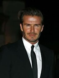 Former England soccer captain David Beckham arrives for a London Fashion Week event to celebrate the Global Fund in London September 16, 2013. REUTERS/Eddie Keogh