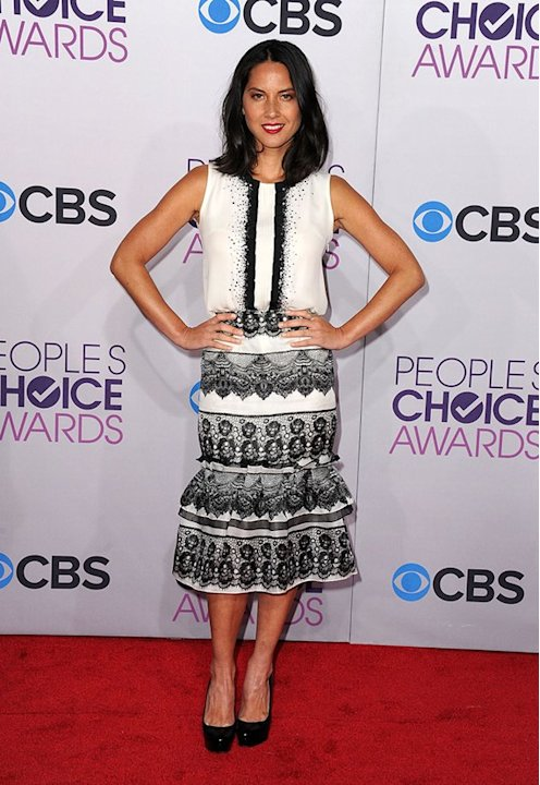 "WORST: Olivia Munn.  While black and white is always a chic combination on the red carpet, the gorgeous ""Newsroom"" star looks positively frumpy in this ruffled number."