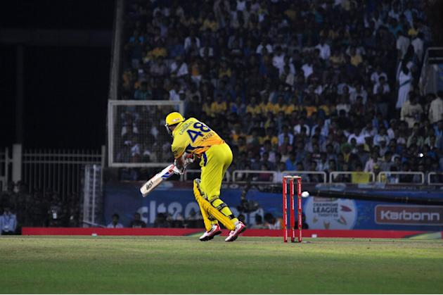 Chennai Super Kings batsman Michael Hussey plays a shot during match against Brisbane Heat during CLT20 Match at JSCA Stadium in Ranchi on Sept. 28, 2013. (Photo: IANS)