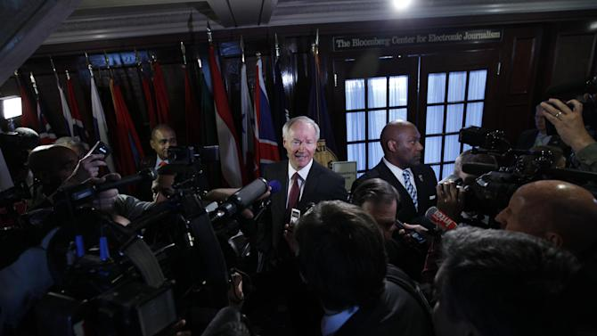 National School Shield Task Force Director, former Arkansas Rep. Asa Hutchinson speaks with reporters after a news conference  at National Press Club in Washington, on Tuesday, April 2, 2013. The National School Shield program is a frame work to arm security guards in any school system who want to be part of the program. (AP Photo/Jose Luis Magana)